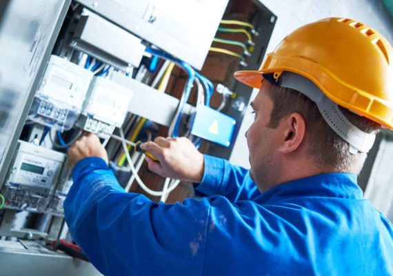 Engineer carrying out electrical maintenance on distribution board
