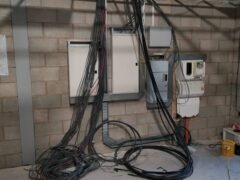 Armoured cable attached to distribution board
