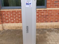 Stand alone electric vehicle charger on car park