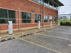 Electric vehicle charges in car park