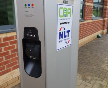 Close up of electric vehicle charger in car park