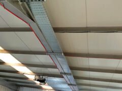 Tray attached to warehouse ceiling