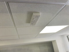 Twin power sockets attached to ceiling
