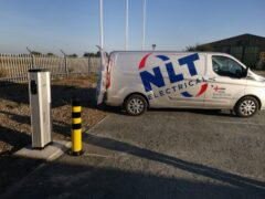 NLT van parked next to new EV charger